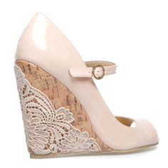 Glue a doily to any cork wedge to get the look. Don't love the pink, so this would be a good way to get the look.