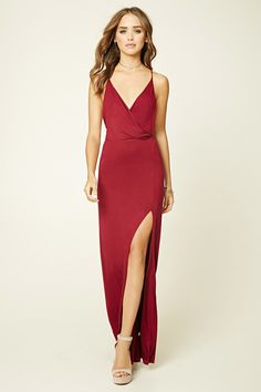 Forever 21 A knit maxi dress featuring a surplice front, V-neckline, crisscross spaghetti straps, and a side slit.