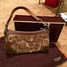 Coach bronze/gold handbag Small bronze/gold shoulder handbag in coach signature print. Only used once...almost new Coach Bags Mini Bags