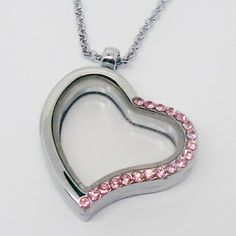 http://www.treasurecharms.com/  TREASURE CHARMS over 30 GLASS LOCKETS to choose from and over 300 CHARMS to fit inside, with out breaking the bank.