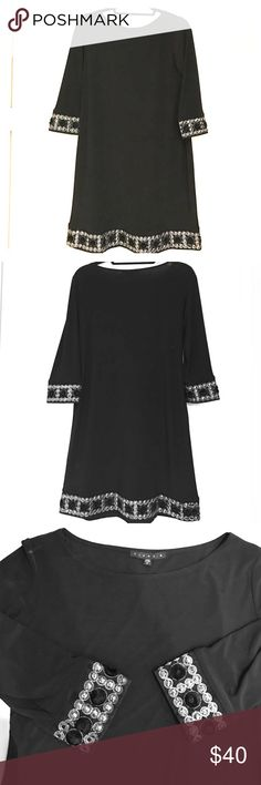Tiana B. Dress - Black with intricate detail Beautiful black Tiana B dress size small with intricate detailing on the bottom of sleeves and bottom dress.   Can be worn casually or dressy.  Measures 34  inches long, sleeves 16 inches from shoulder, dress is a relaxed and flowing A-line shape thus: bottom measures 22 inches across & bust measures 18 inches across. Material is 95% polyester and 5% spandex. Tiana B. Dresses Midi