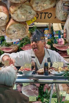 Prosciutto Shop, Florence, Italy  (I think he's opening his own mouth to invite customer to taste a sample)