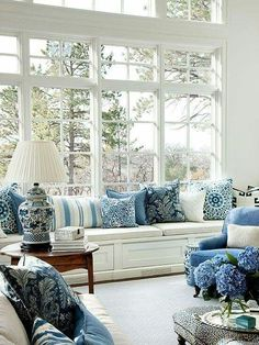 textiles transform an all white room for spring and summer. DesignNashville.com fabrics, custom draperies, and pillows #preppy_style_decor