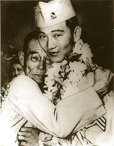 Iuemon Kiyama tearfully embracing his son, the decorated Sgt. Howard Kiyama of the 442nd Regimental Combat Team, upon his return to Hawaii from Europe.