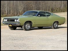 1969 Ford Torino Cobra  428 CI, 4-Speed.  Was my 1969 Ford Torino like this car?  Uh...no.  Mine was a 4-door shared with my best friend Kirk in college.  We owned this...well...the car was a kinda like this...for a few months until I bought my aunt and uncle's 1972....  Dates owned: Sept. 1982-Aug. 1982.