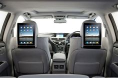 iPad head rests ipadcarholder.com, and i need this...excellent for cabin rides and kiddos