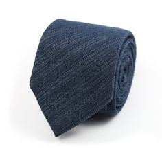 Handmade in Italy, this distinctive, contemporary tie is cut from a fine raw indigo silk and linen denim, which feels suitably chic and textural for summer.