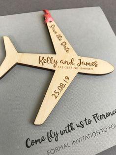 Wooden aeroplane save the date. Perfect for a wedding in a beautiful destination. #weddingideas #destinationwedding