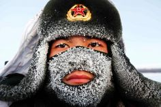 Frost covers the face of a People's Liberation Army soldier in China