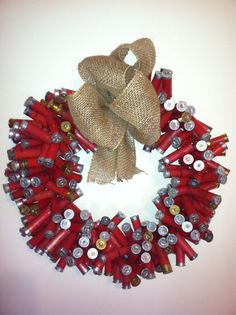 "Shotgun Shell Wreaths My husband would love this with a note on a board saying something like ""Let's go Kill somethin"""