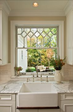 Farmhouse kitchen sink with pretty stained glass window.
