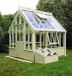 "Victorian Style greenhouse from old windows... would like to build small free standing greenhouses if I have any windows left after building the greenhouse. But I like how they""ve built this♥"