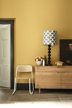 Little Greene Paint - Yellow walls with Black coloured skirting boards
