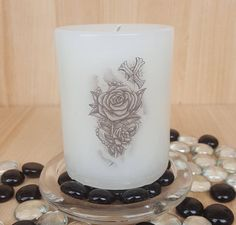 "Scented ""In Memoriam"" pillar candle/lost loved ones/rose,rosaries and cross/names can be added at no additional cost      Available in these lovely fragrances:    Blueberry Muffin, The fragrance is juicy and mouth-watering, and makes an ideal present for someone who loves a fruity, warm fragrance.    The scent of lavender is known to ease tension and promote restful sleep. Our Lavender candle creates a great ambience.    Chocolate, A rich, sweet chocolate fragrance with sweet notes of…"