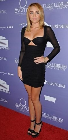 Miley Cyrus in a provocative body conscious cutout LBD.