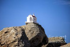 Landscape Photography of a tiny little church placed on a bed of rocks in Mykonos Island Greece.