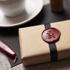 Brown Kraft paper , black ribbon, red wax seal