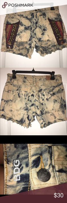 Urban Outfitters BDG shorts these shorts are super cute!! they are from Urban Outfitters (brand BDG denim) and are high rise, they are acid wash and distressed (2 small jewels are missing but it just adds to the distressed look) size 25/26. pair them with tights & boots for fall! BDG Shorts Jean Shorts