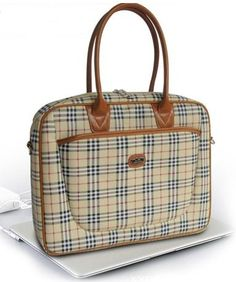 Burberry knock-off but undeniably classic and versatile...