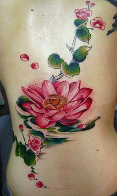 Elegant Lotus Tattoo On Back Body