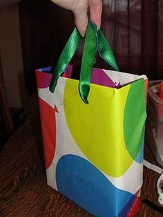 Need a gift bag, but don't want to run to the store? Wrap an empty cereal box & use ribbon for handles.