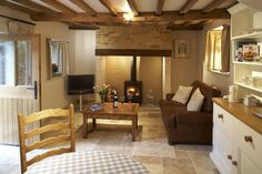 fireplace in cotswolds kitchen - Google Search