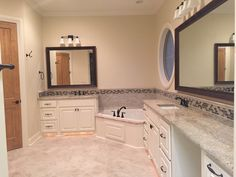 Master bath with double vanity, granite counter tops, and custom window.