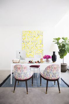 Eva Chen's understated white desk topped with a Christopher Spitzmiller lamp is given a playful twist when surrounded by colorful accents   domino.com