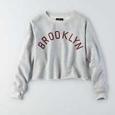 American Eagle Cropped Brooklyn Sweatshirt ($35) ❤ liked on Polyvore featuring tops, hoodies, sweatshirts, grey, crew neck sweat shirt, gray crewneck sweatshirt, cropped sweatshirt, grey crew neck sweatshirt and crop top