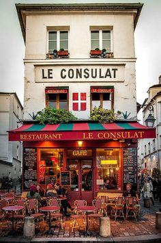 Montmartre, Paris, France --To sit outside a cafe and have a coffee and watch the people go by...