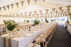 Beautiful. Absolutely perfect.  Image by Isabel Maria - Rustic Marquee Wedding In The South West At Court Farm Near Bath With Bride In Charlie Brear Gown From The Decades Collection And Groom In Navy Reiss Suit