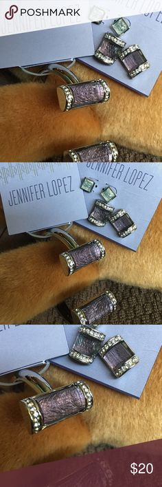 Jennifer Lopez purple bracelet and earring set New unopened , silver Jennifer Lopez set.   Beautiful purple surrounded by crystal stones catch the light for a wonder shimmer.   An extra pair or earrings come on the card for a change of pace.   They are a grey they also catch the light.  The bracelet has a spring closure.  Bracelet retail $30.  Earrings retail $18. Jennifer Lopez Jewelry Earrings