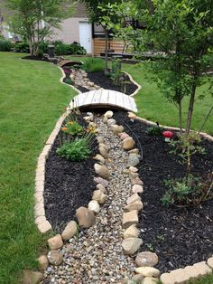 Dry river bed landscaping ideas: long dry river bed with bridges Interested in renovating your garden? Nothing is more stunning than these dry river bed landscaping ideas. Read on, get inspired, and learn how! Cheap Landscaping Ideas, Outdoor Landscaping, Front Yard Landscaping, Acreage Landscaping, Dry Riverbed Landscaping, Mulch Ideas, Landscaping Blocks, Landscaping Equipment, Back Yard Landscape Ideas