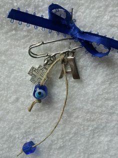 Martyrika larger pin with initial, mataki, cross and bead