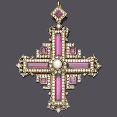 A late 19th century garnet and seed pearl brooch/pendant. Designed as a step-cut…