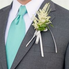 gray suit with turquoise tie