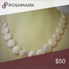 """NEW Freshwater Coin Shaped Pearl Sterling Silver NEW Freshwater Coin Shape Pearl Sterling Silver Necklace 18"""" long. These coined shaped pearls are a true testimony to elegance for a price you can afford. They are affixed with a Sterling Silver Clasp. As an added bonus, a bracelet comes with it by Best Silver. Best Silver Jewelry Necklaces"""