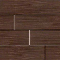 Move over hardwood! Wood look porcelain tile is taking center stage. These new stars offer the look and feel of genuine wood - even some saw marks in a spectrum of styles from reclaimed rustic to modern gray-washed. Choose these stunning yet durable tiles to headline your design! Featured: Sygma Chocolate