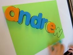 use magnetic letters to trace onto paper, creating a puzzle for Johnny to match up the letters of his name
