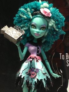 I picked her up at Target - Honey Swamp new monster from Monster High to be released in early 2014. This is the first monster with curly kinky hair & assumed to be the daughter of the Swamp Monster. Her name is also a name of a town in Louisiana that has a legend of a swamp monster that dwells in the the swampy wet lands.