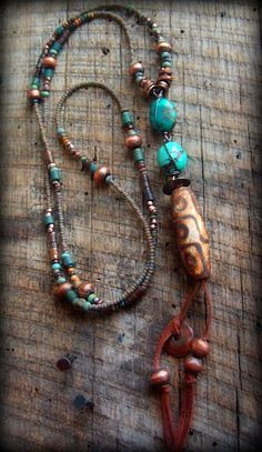 """Tibetan Agate Old World Glass Turquoise Copper by yuccabloom """"oblong focal of Tibetan Dzi Agate (approx 1.5""""long) African copper globes and heishi beads mix of Navajo Turquoise and earthy tone Picasso glass beads, Vintage African coconut shell discs from Ghana, nuggets of brilliant Turquoise, tubes of dark brown bone, disc of copper Mykonos bead, suede leather in deerskin, 40"""" to bottom of Agate Stone, can be worn long, or wrap it as a lariat"""""""