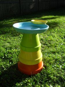 Bird Bath  The base of the bird bath is simply three terra cotta pots (turned upside down, of course) in 14″, 12″, and 10″ sizes. The water container is a 16″ terra cotta saucer. The containers are held together with acrylic based silicone caulk