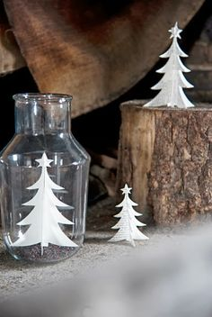 Cut out paper art in Xmas shapes and place into glass jars for table decoration
