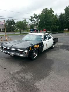 Dodge patrol car. Note the front plate. 55 mph was the law of the land for many years.