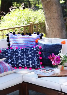 DIY Pom Pom Pillows-I could probably pick up some pom pom trim from Joann's to save a little time...