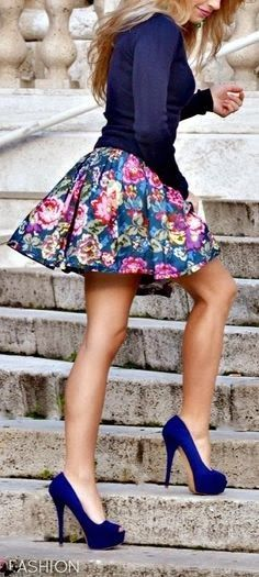Cute flowery ladies colorful skirt, blue shoes and blue shirt
