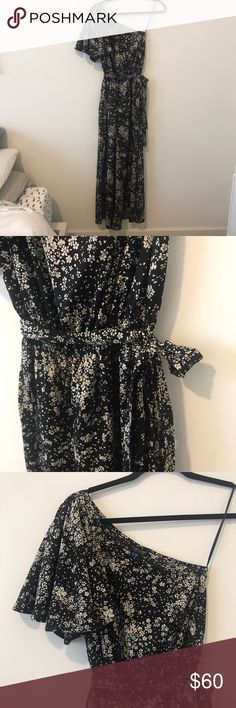 Topshop floral one shoulder jumpsuit Trendy one shoulder & wide legged jumpsuit in chiffon material. Beautiful floral pattern. Belt attached for a more flattering fit. Topshop Dresses One Shoulder