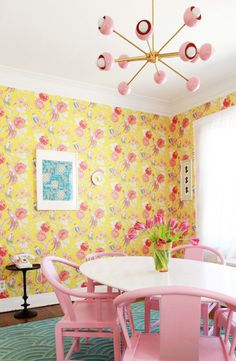 Modern feminine dining room with yellow floral wallpaper and mid century modern inspired light pink and brass chandelier paired with a tulip dining room table and pink dining room chairs. Pink Dining Rooms, Dining Room Chairs, Sputnik Chandelier, Dining Room Design, Mid-century Modern, Mid Century, Ceiling Canopy, Wallpaper, Floral