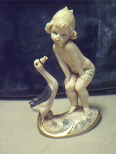 Depose Italy, Figurine with spider mark & number, Cherub with a goose, beautiful