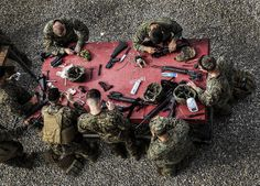 Marines do a little cleaning after a day at the range. (U.S. Marine Corps photo by Cpl. Emmanuel Ramos/Released)